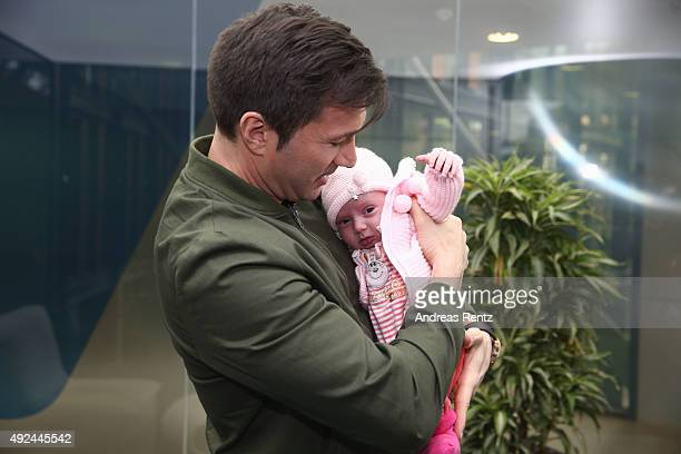 Lucas Cordalis poses with newborn daughter Sophia on October 13 2015 in Cologne Germany It was first public appearance of the couple Daniela...