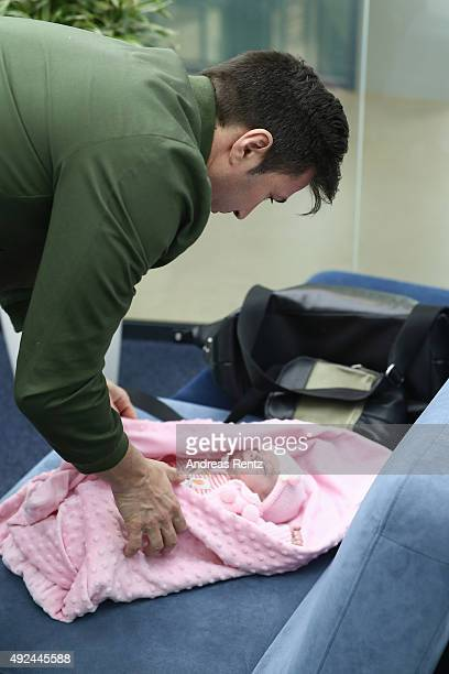 Lucas Cordalis takes care of newborn daughter Sophia on October 13 2015 in Cologne Germany It was first public appearance of the couple Daniela...
