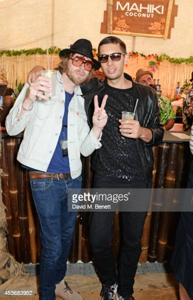 Lucas Crowther of The Rifles and Example attend the Mahiki Rum Bar for the launch of the Mahiki Rum Family backstage during day 1 of the V Festival...
