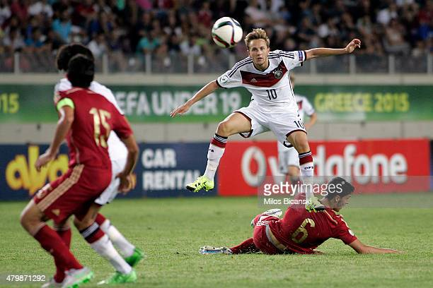 Lucas Cueto of Germany competes with Mikel Merino of Spain during the UEFA U19 Championship 2015 final tournament match between Spain and Germany at...