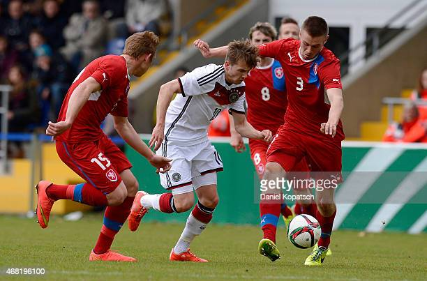 Lucas Cueto of Germany is challenged by Jakub Sural of Czech Republic and Miroslav Routek of Czech Republicduring the UEFA Under19 Elite Round match...
