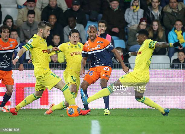Lucas Deaux of Nantes Alejandro Bedoya of Nantes Yassine Jebbour of Montpellier and Serge Gakpe of Nantes in action during the french Ligue 1 match...