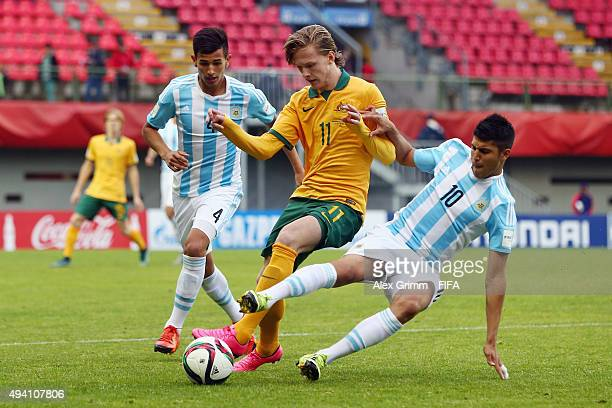 Lucas Derrick of Australia is challenged by Matias Escudero and Exequiel Palacios of Argentina during the FIFA U17 World Cup Chile 2015 Group C match...