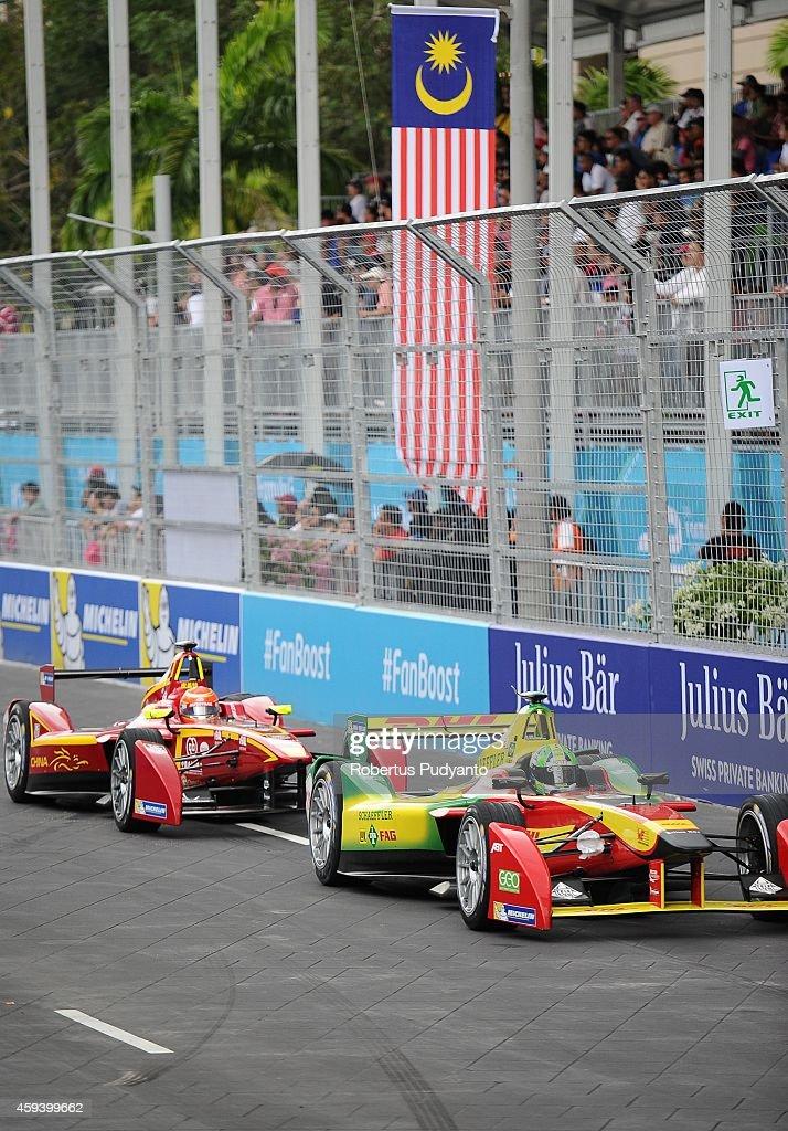 Lucas di Grassi of Brazil and Audi Sport ABT Formula E Team leads Nelson Piquet Jr of Brazil and China Racing Formula E Team during the FIA Formula E...