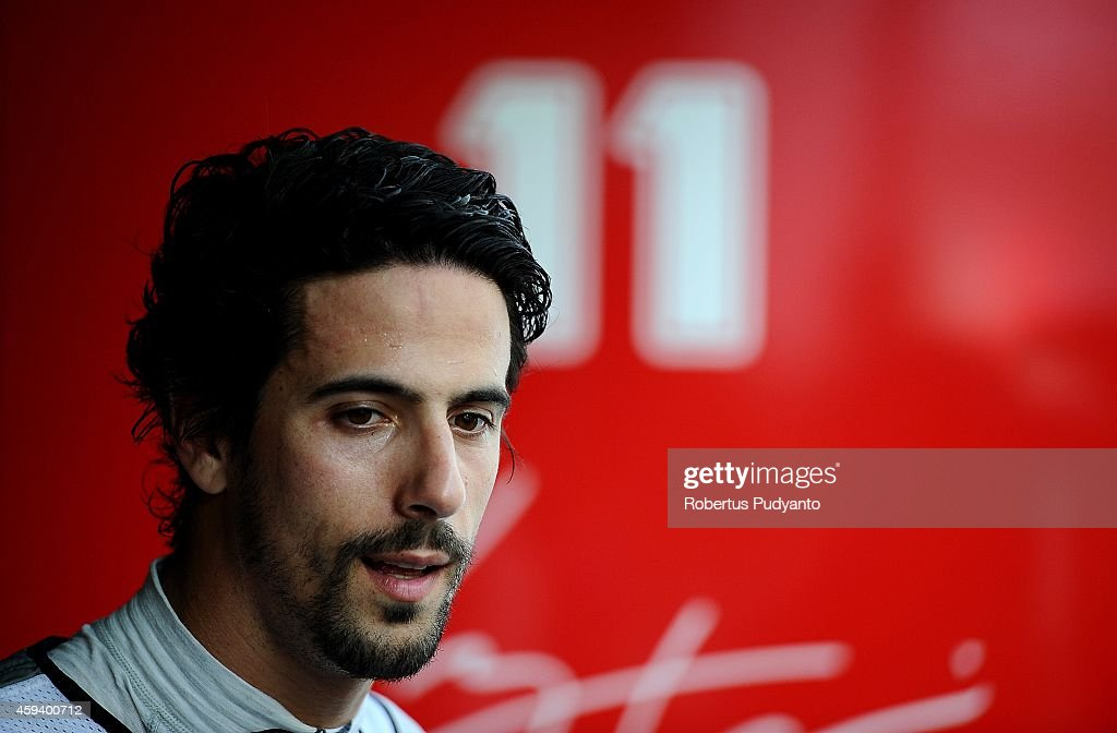 <a gi-track='captionPersonalityLinkClicked' href=/galleries/search?phrase=Lucas+di+Grassi&family=editorial&specificpeople=4237493 ng-click='$event.stopPropagation()'>Lucas di Grassi</a> of Brazil and Audi Sport ABT Formula E Team prepares in the garage during the Formula E Championship race on November 22, 2014 in Putrajaya, Malaysia.