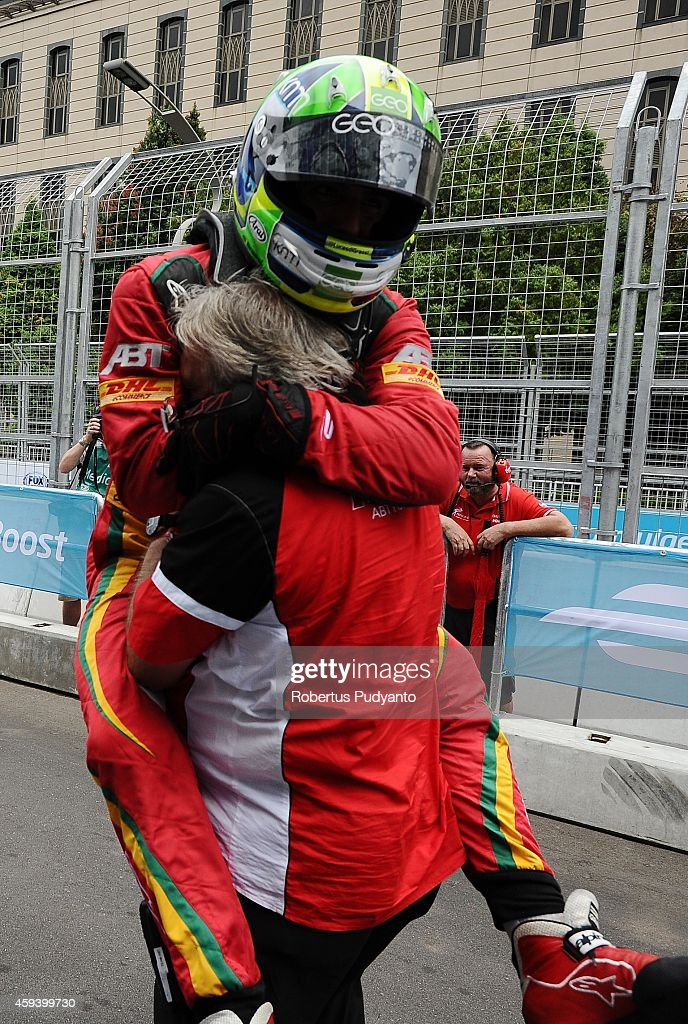 <a gi-track='captionPersonalityLinkClicked' href=/galleries/search?phrase=Lucas+di+Grassi&family=editorial&specificpeople=4237493 ng-click='$event.stopPropagation()'>Lucas di Grassi</a> of Brazil and Audi Sport ABT Formula E Team reacts at Parc Femme after taking runner-up position in the FIA Formula E Putrajaya ePrix Championship race on November 22, 2014 in Putrajaya, Malaysia.
