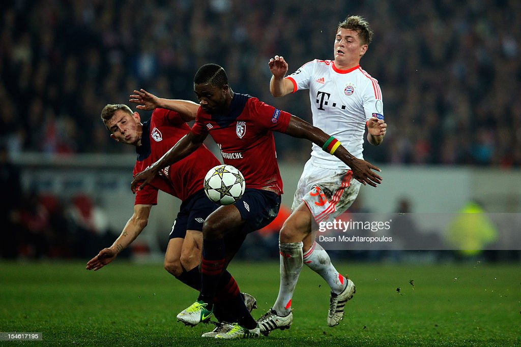 Lucas Digne (#3) and Aurelien Chedjou (#22) of Lille battle for the ball with <a gi-track='captionPersonalityLinkClicked' href=/galleries/search?phrase=Toni+Kroos&family=editorial&specificpeople=638597 ng-click='$event.stopPropagation()'>Toni Kroos</a> of Bayern Munich during the Group F UEFA Champions League match between OSC Lille and FC Bayern Muenchen at Grand Stade Lille Metropole on October 23, 2012 in Lille, France.