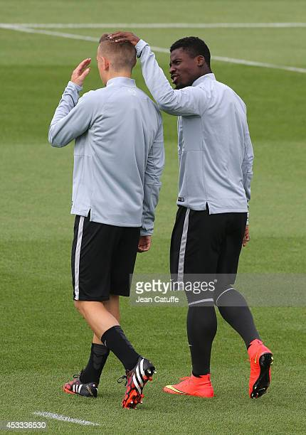 Lucas Digne and Serge Aurier of PSG warm up during a practice session at the Paris SaintGermain Ooredoo Training Camp on August 7 2014 in...