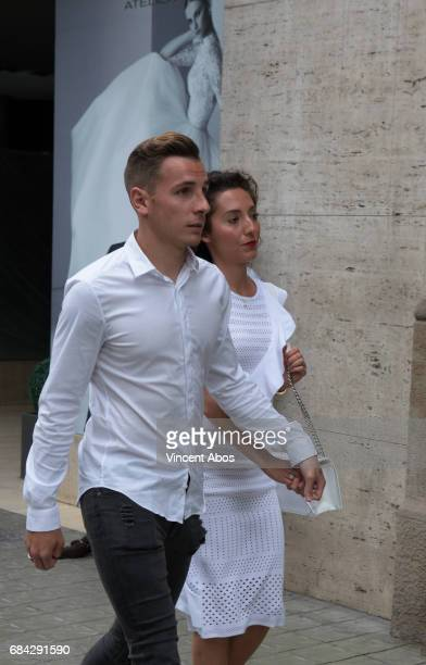 Lucas Digne and Tiziri Digne are seen arriving at the new Sarkany Boutique opening on May 17 2017 in Barcelona Spain