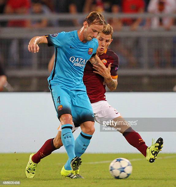 Lucas Digne of AS Roma competes for the ball with Ivan Rakitic of FC Barcelona during the UEFA Champions League Group E match between AS Roma and FC...