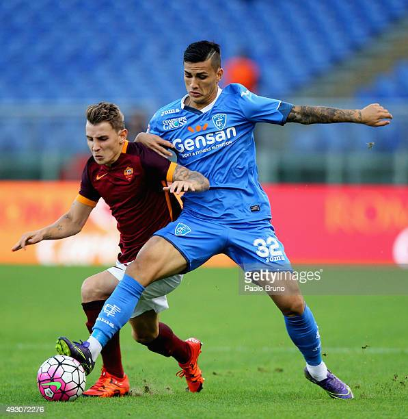 Lucas Digne of AS Roma competes for the ball with Leandro Paredes of Empoli FC during the Serie A match between AS Roma and Empoli FC at Stadio...