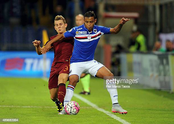 Lucas Digne of AS Roma competes for the ball with Luis Muriel of UC Sampdoria during the Serie A match between UC Sampdoria and AS Roma at Stadio...