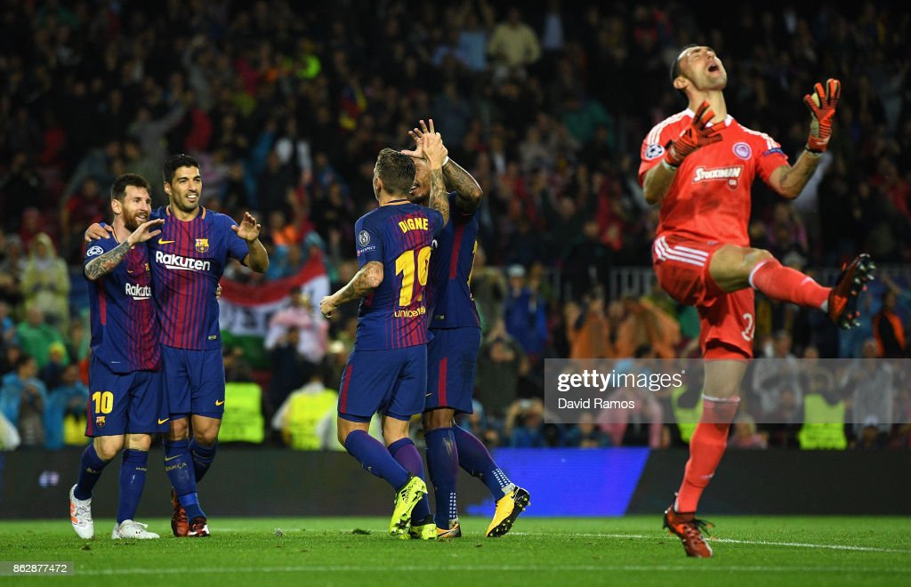 Lucas Digne of Barcelona celebrates scoring his sides third goal with Lionel Messi of Barcelona, Luis Suarez of Barcelona as Silvio Proto of Olympiacos reacts during the UEFA Champions League group D match between FC Barcelona and Olympiakos Piraeus at Camp Nou on October 18, 2017 in Barcelona, Spain.