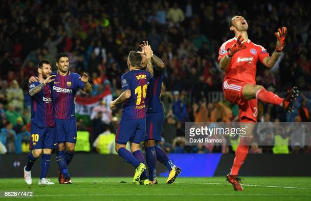 Lucas Digne of Barcelona celebrates scoring his sides third goal with Lionel Messi of Barcelona Luis Suarez of Barcelona as Silvio Proto of...