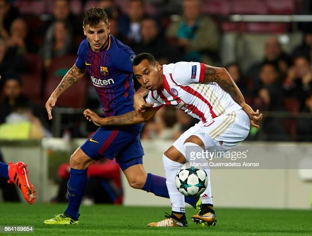 Lucas Digne of Barcelona competes for the ball with Felipe Pardo of Olympiakos during the UEFA Champions League group D match between FC Barcelona...