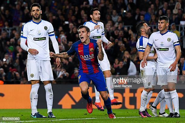 Lucas Digne of FC Barcelona celebrates after scoring his team's first goal during the Copa del Rey round of 32 second leg match between FC Barcelona...
