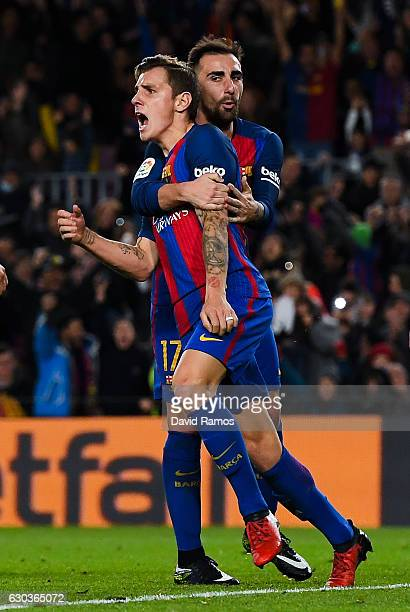Lucas Digne of FC Barcelona celebrates with his team mate Paco Alcacer after scoring his team's first goal during the Copa del Rey round of 32 second...