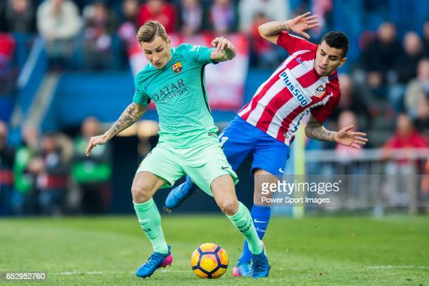 Lucas Digne of FC Barcelona fights for the ball with Angel Correa of Atletico de Madrid during their La Liga match between Atletico de Madrid and FC...