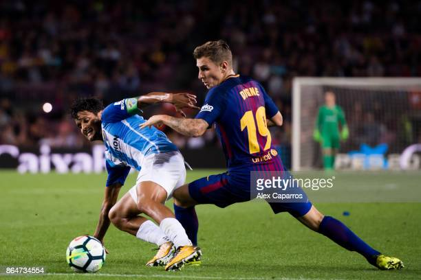 Lucas Digne of FC Barcelona fights for the ball with Roberto Rosales of Malaga CF during the La Liga match between Barcelona and Malaga at Camp Nou...