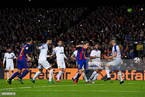 Lucas Digne of FC Barcelona scores the opening goal during the Copa del Rey round of 32 second leg match between FC Barcelona and Hercules at Camp...