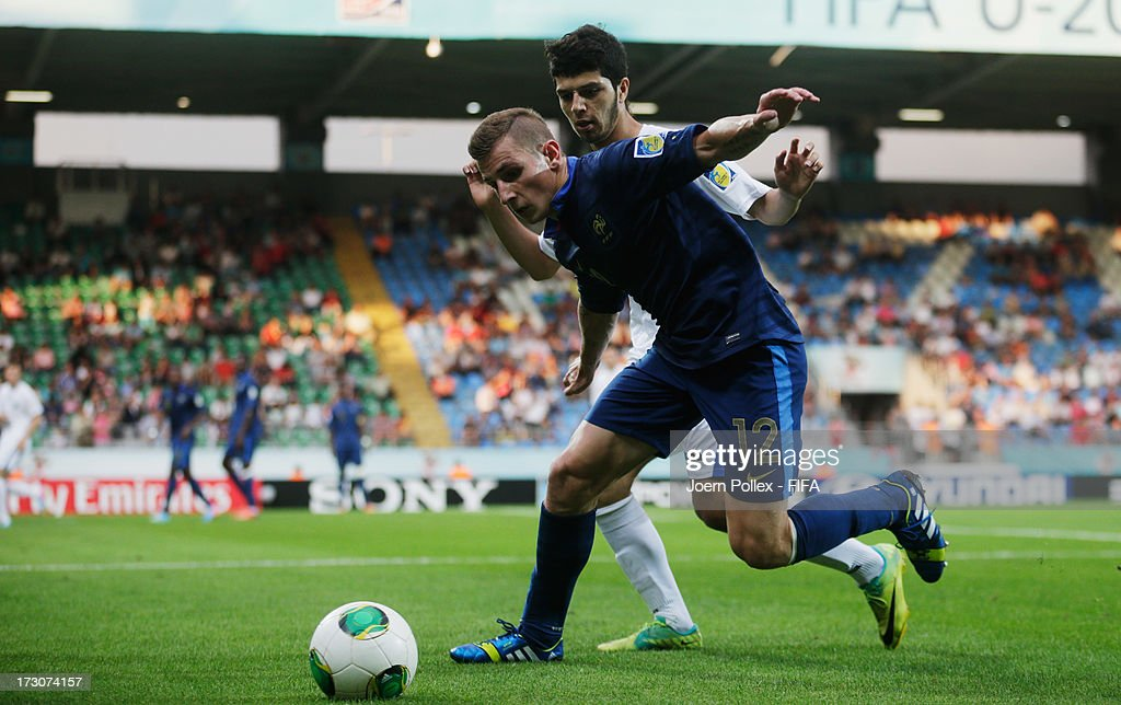 <a gi-track='captionPersonalityLinkClicked' href=/galleries/search?phrase=Lucas+Digne&family=editorial&specificpeople=5805298 ng-click='$event.stopPropagation()'>Lucas Digne</a> (L) of France and Jaloliddin Masharipov of Uzbekistan compete for the ball during the FIFA U-20 World Cup Quarter Final match between France and Uzbekistan at Yeni Sehir Stadium on July 6, 2013 in Rize, Turkey.