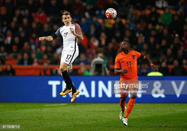 Lucas Digne of France wins a header with Quincy Promes of the Netherlands during the International Friendly match between Netherlands and France at...