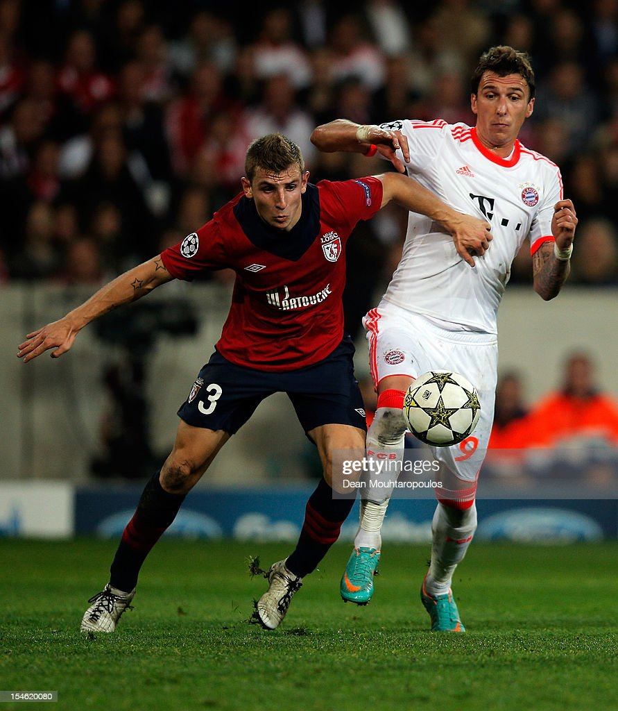 Lucas Digne (#3) of Lille battles for the ball with <a gi-track='captionPersonalityLinkClicked' href=/galleries/search?phrase=Mario+Mandzukic&family=editorial&specificpeople=4476149 ng-click='$event.stopPropagation()'>Mario Mandzukic</a> of Bayern Munich during the Group F UEFA Champions League match between OSC Lille and FC Bayern Muenchen at Grand Stade Lille Metropole on October 23, 2012 in Lille, France.