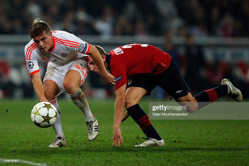 Lucas Digne (#3) of Lille battles for the ball with <a gi-track='captionPersonalityLinkClicked' href=/galleries/search?phrase=Toni+Kroos&family=editorial&specificpeople=638597 ng-click='$event.stopPropagation()'>Toni Kroos</a> of Bayern Munich during the Group F UEFA Champions League match between OSC Lille and FC Bayern Muenchen at Grand Stade Lille Metropole on October 23, 2012 in Lille, France.