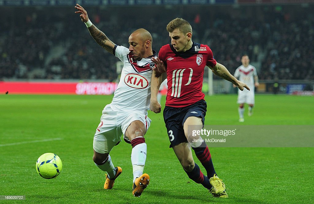 Lucas Digne of Lille battles with <a gi-track='captionPersonalityLinkClicked' href=/galleries/search?phrase=Julien+Faubert&family=editorial&specificpeople=600452 ng-click='$event.stopPropagation()'>Julien Faubert</a> of Bordeaux during the Ligue 1 match between LOSC Lille Metropole v FC Girondins de Bordeaux at the Grand Stade Lille-Metropole on March 3, 2013 in Lille, France.