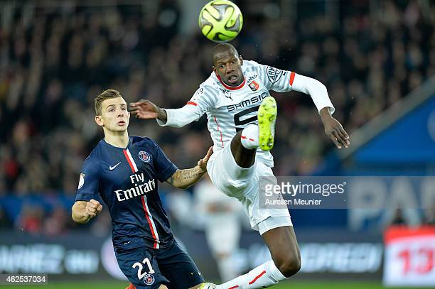 Lucas Digne of Paris Saint Germain and Gelson Fernandes of Stade Rennais in action during the 23rd day of the French Ligue 1 between Paris Saint...