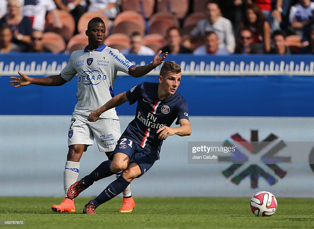 <a gi-track='captionPersonalityLinkClicked' href=/galleries/search?phrase=Lucas+Digne&family=editorial&specificpeople=5805298 ng-click='$event.stopPropagation()'>Lucas Digne</a> of PSG in action is watched by <a gi-track='captionPersonalityLinkClicked' href=/galleries/search?phrase=Floyd+Ayite&family=editorial&specificpeople=5969808 ng-click='$event.stopPropagation()'>Floyd Ayite</a> of Bastia during the French Ligue 1 match between Paris Saint Germain FC and SC Bastia at Parc des Princes stadium on August 16, 2014 in Paris, France.