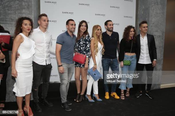 Lucas Digne Paco Alcacer and Denis Suarez attend the Sarkany Shoes Boutique Openeing in Barcelona on May 17 2017 in Barcelona Spain