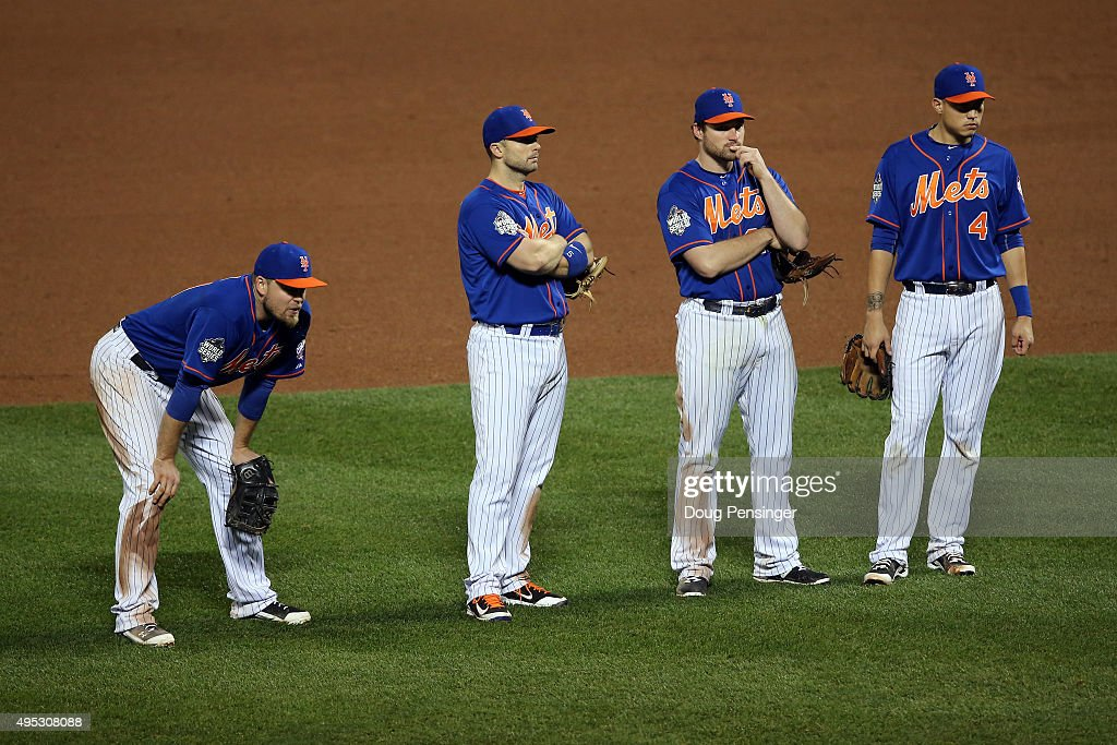 Lucas Duda David Wright Daniel Murphy and Wilmer Flores of the New York Mets look on as Matt Harvey is relieved in the ninth inning against the...