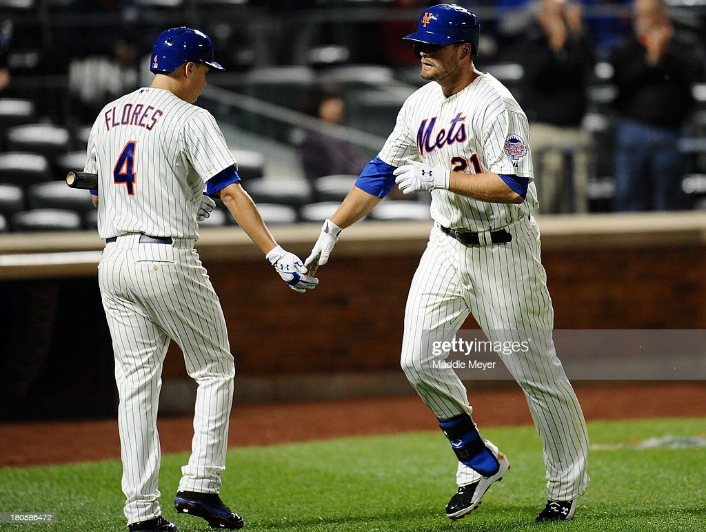 <a gi-track='captionPersonalityLinkClicked' href=/galleries/search?phrase=Lucas+Duda&family=editorial&specificpeople=7172550 ng-click='$event.stopPropagation()'>Lucas Duda</a> #21 of the New York Mets celebrates a home run with teammate <a gi-track='captionPersonalityLinkClicked' href=/galleries/search?phrase=Wilmer+Flores&family=editorial&specificpeople=5970686 ng-click='$event.stopPropagation()'>Wilmer Flores</a> #4 during the third inning of game two of a doubleheader against the Miami Marlins on September 14, 2013 at Citi Field in the Flushing neighborhood of the Queens borough of New York City.
