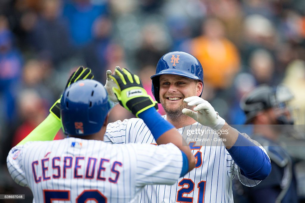 Lucas Duda of the New York Mets celebrates his first home run at home plate with Yoenis Cespedes of the New York Mets during the Atlanta Braves Vs...