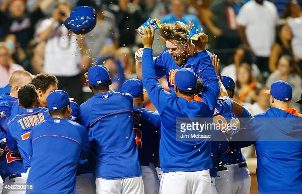 Lucas Duda of the New York Mets celebrates his ninth inning game winning two run home run against the Houston Astros with his teammates at Citi Field...