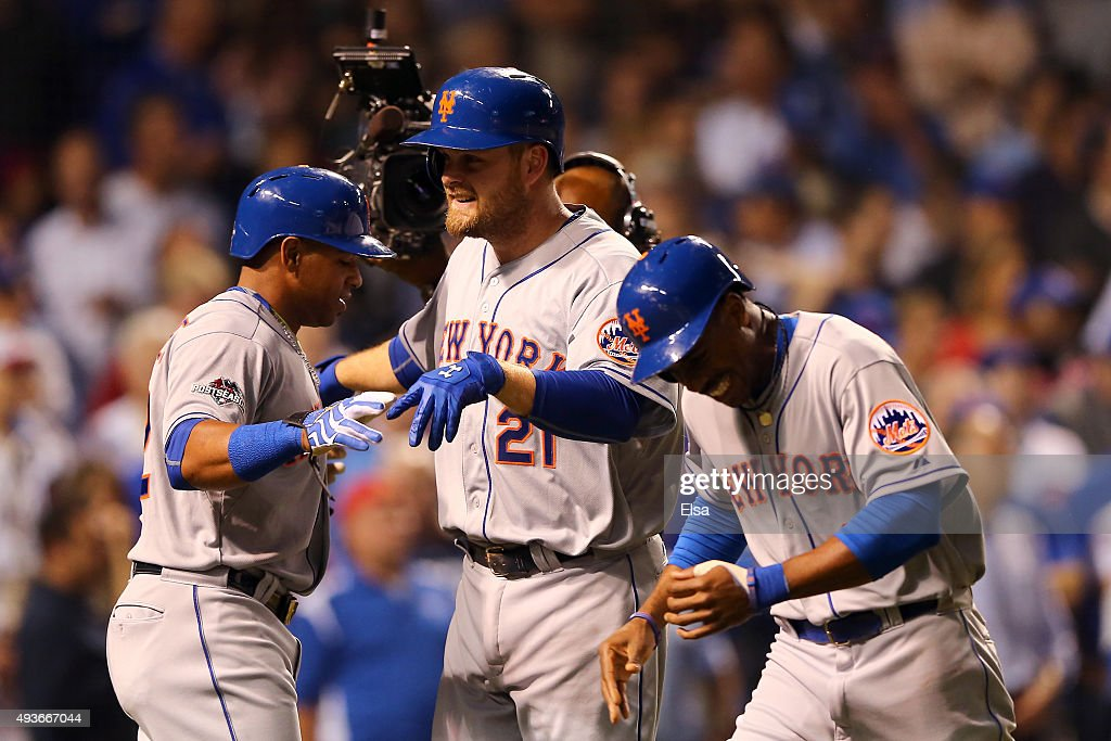 Lucas Duda of the New York Mets celebrates with Curtis Granderson and Yoenis Cespedes after hitting a three run home run in the first inning against...