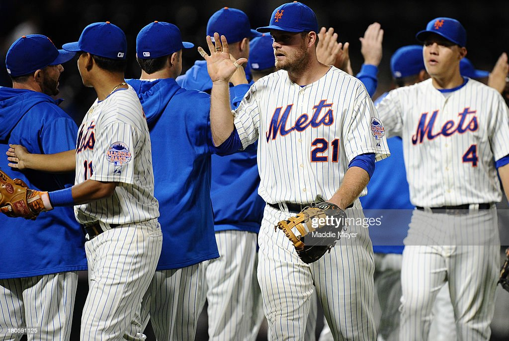 Lucas Duda #21 of the New York Mets celebrates with teammates after game two of a doubleheader against the Miami Marlins on September 14, 2013 at Citi Field in the Flushing neighborhood of the Queens borough of New York City. The Mets defeated the Marlins 3-1.