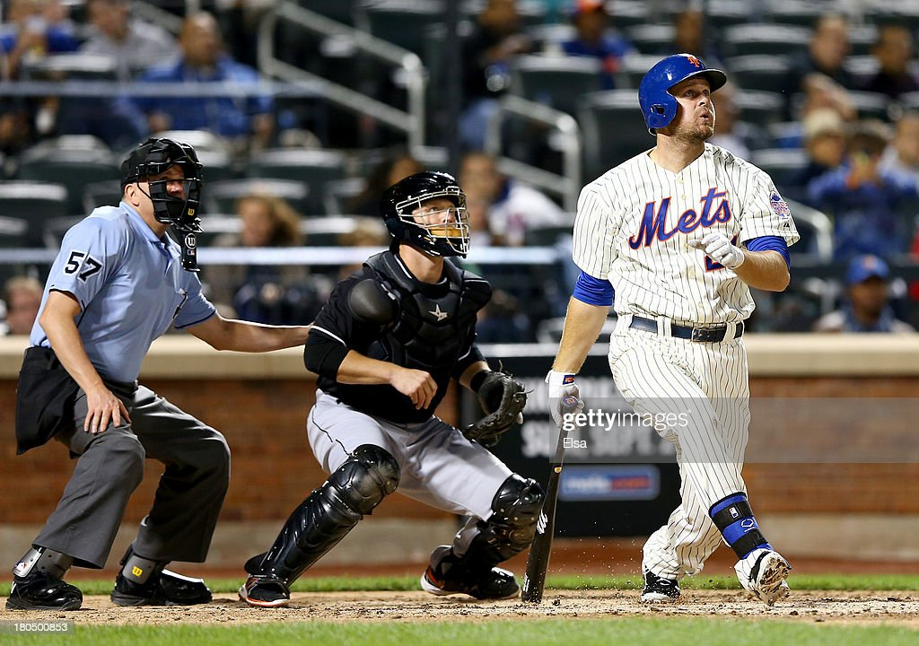 <a gi-track='captionPersonalityLinkClicked' href=/galleries/search?phrase=Lucas+Duda&family=editorial&specificpeople=7172550 ng-click='$event.stopPropagation()'>Lucas Duda</a> #21 of the New York Mets hits a three run homer as <a gi-track='captionPersonalityLinkClicked' href=/galleries/search?phrase=Koyie+Hill&family=editorial&specificpeople=221625 ng-click='$event.stopPropagation()'>Koyie Hill</a> #46 of the Miami Marlins catches on August 13, 2013 at Citi Field in the Flushing neighborhood of the Queens borough of New York City.