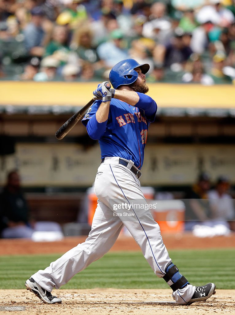 Lucas Duda of the New York Mets hits a threerun home run in the third inning of their game against the Oakland Athletics at Oco Coliseum on August 20...
