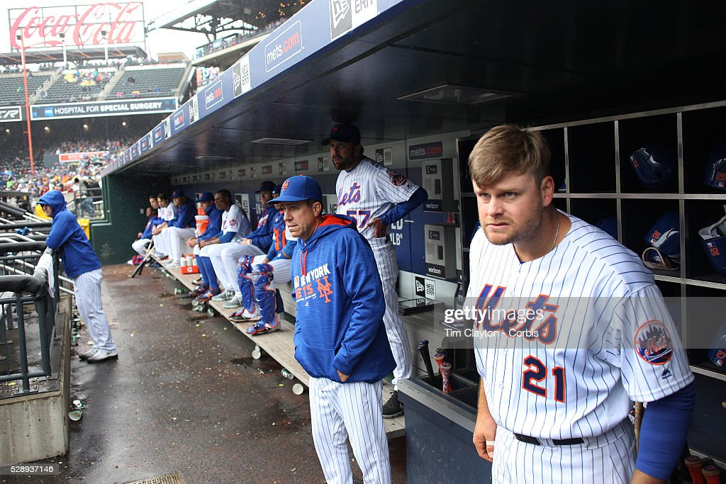 Lucas Duda of the New York Mets in the dugout watching play as he prepares to bat during the Atlanta Braves Vs New York Mets MLB regular season game...