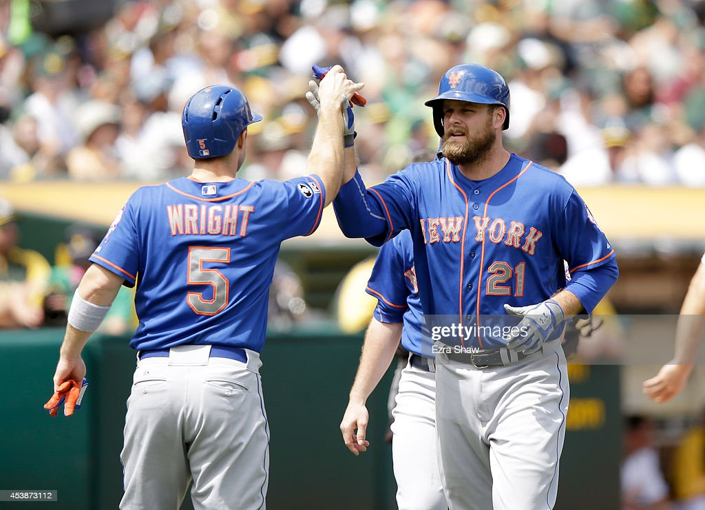 <a gi-track='captionPersonalityLinkClicked' href=/galleries/search?phrase=Lucas+Duda&family=editorial&specificpeople=7172550 ng-click='$event.stopPropagation()'>Lucas Duda</a> #21 of the New York Mets is congratulated by <a gi-track='captionPersonalityLinkClicked' href=/galleries/search?phrase=David+Wright+-+Baseball+Player&family=editorial&specificpeople=209172 ng-click='$event.stopPropagation()'>David Wright</a> #5 after he hit a three-run home run off of Jeff Samardzija #29 of the Oakland Athletics in the third inning at O.co Coliseum on August 20, 2014 in Oakland, California.