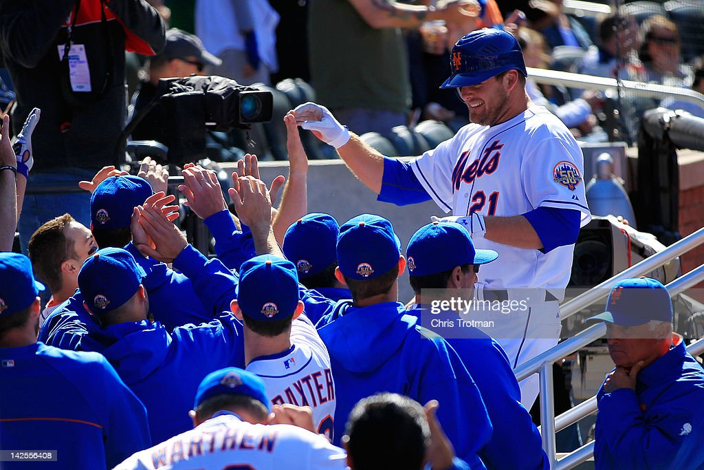 Lucas Duda of the New York Mets is congratulated by his teammates for his homer in the 7th inning against the Atlanta Braves at Citi Field on April 7...