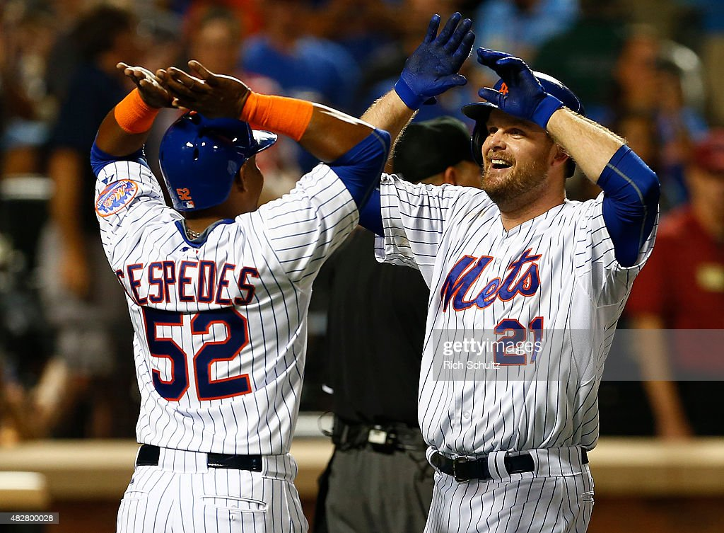 Lucas Duda of the New York Mets is congratulated by Yoenis Cespedes after both scored on Duda's two run home run during the third inning against the...