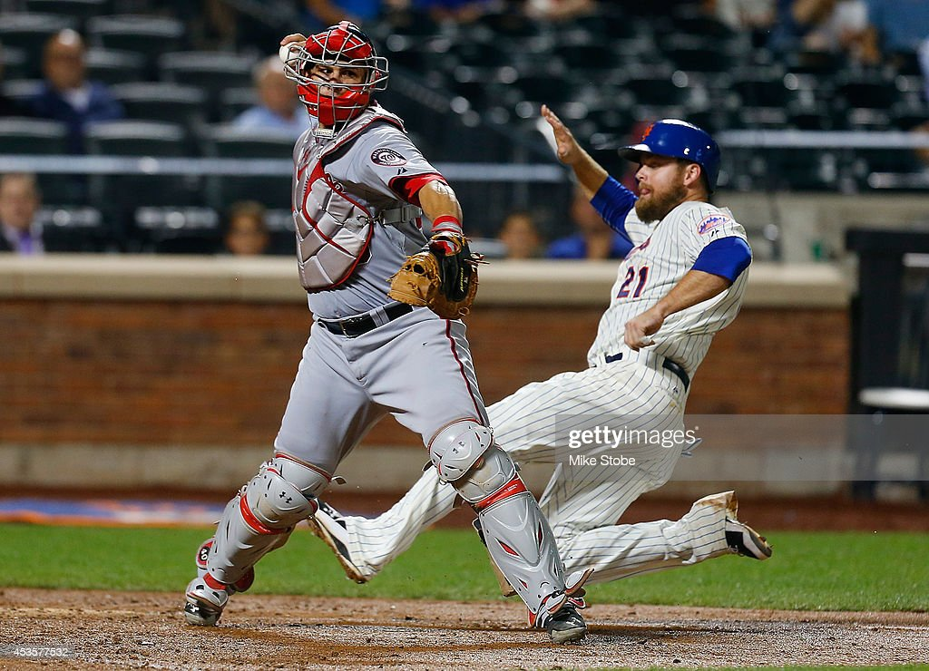 <a gi-track='captionPersonalityLinkClicked' href=/galleries/search?phrase=Lucas+Duda&family=editorial&specificpeople=7172550 ng-click='$event.stopPropagation()'>Lucas Duda</a> #21 of the New York Mets is forced out at home as <a gi-track='captionPersonalityLinkClicked' href=/galleries/search?phrase=Wilson+Ramos&family=editorial&specificpeople=4866956 ng-click='$event.stopPropagation()'>Wilson Ramos</a> #40 of the Washington Nationals is unable to complete the double play at Citi Field on August 13, 2014 in the Flushing neighborhood of the Queens borough of New York City.