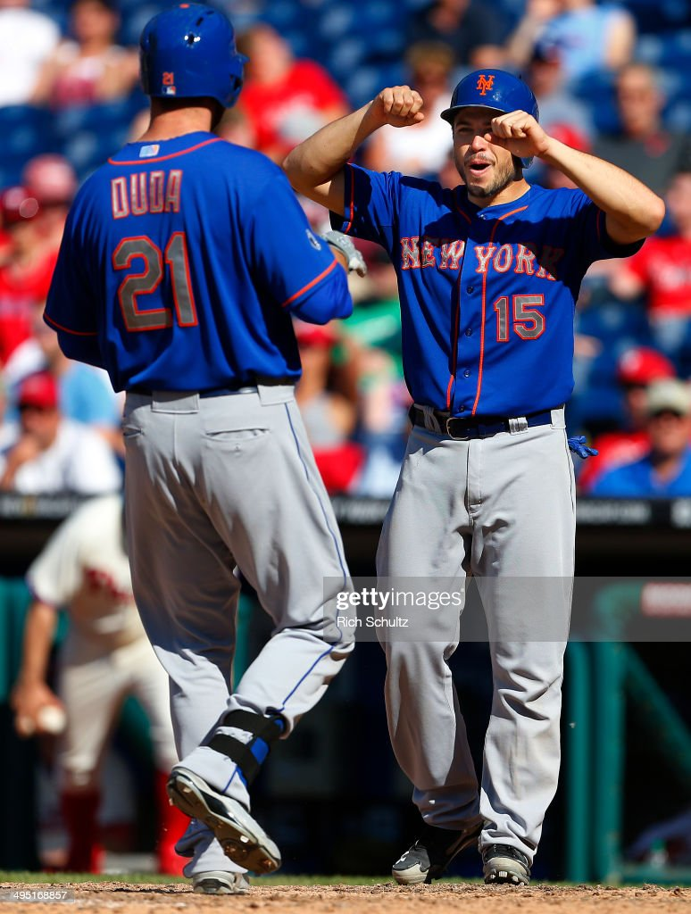<a gi-track='captionPersonalityLinkClicked' href=/galleries/search?phrase=Lucas+Duda&family=editorial&specificpeople=7172550 ng-click='$event.stopPropagation()'>Lucas Duda</a> #21 of the New York Mets is greeted at home plate by Travis d'Arnaud #15 after Duda's two run home run in the eleventh inning to defeat the Philadelphia Phillies 4-3 in a game at Citizens Bank Park on June 1, 2014 in Philadelphia, Pennsylvania.