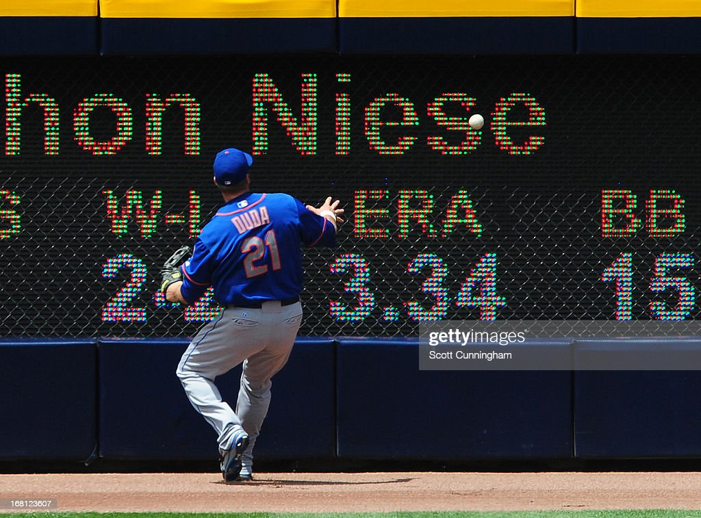 <a gi-track='captionPersonalityLinkClicked' href=/galleries/search?phrase=Lucas+Duda&family=editorial&specificpeople=7172550 ng-click='$event.stopPropagation()'>Lucas Duda</a> #21 of the New York Mets is unable to make a catch during the game against the Atlanta Braves at Turner Field on May 5, 2013 in Atlanta, Georgia.
