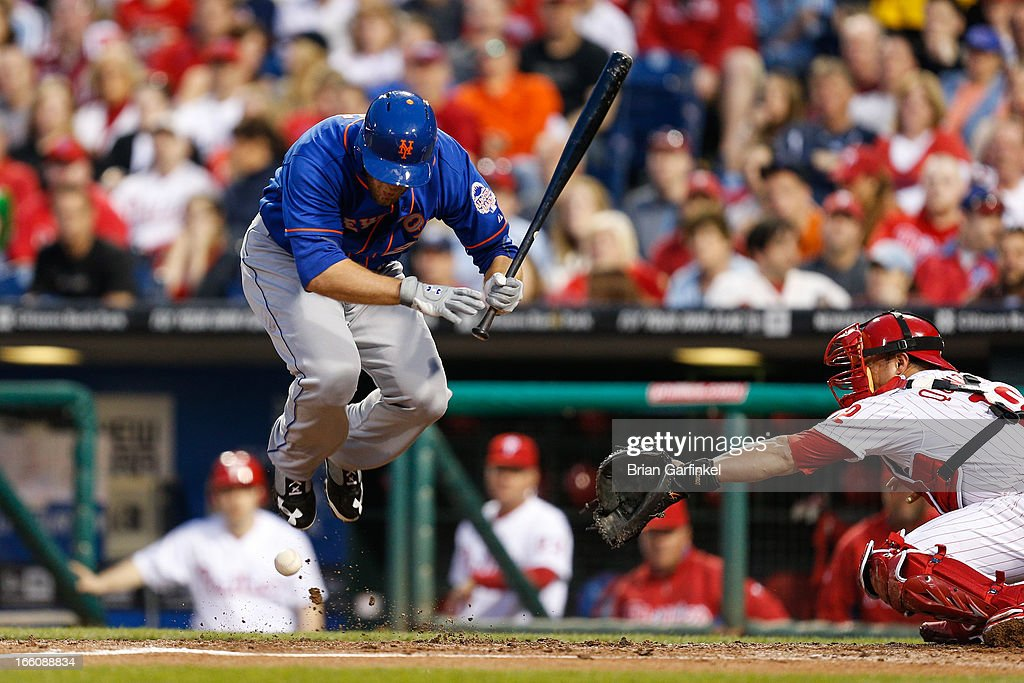 Lucas Duda of the New York Mets jumps out of the way of a pitch in the second inning of the game against the Philadelphia Phillies at Citizens Bank...
