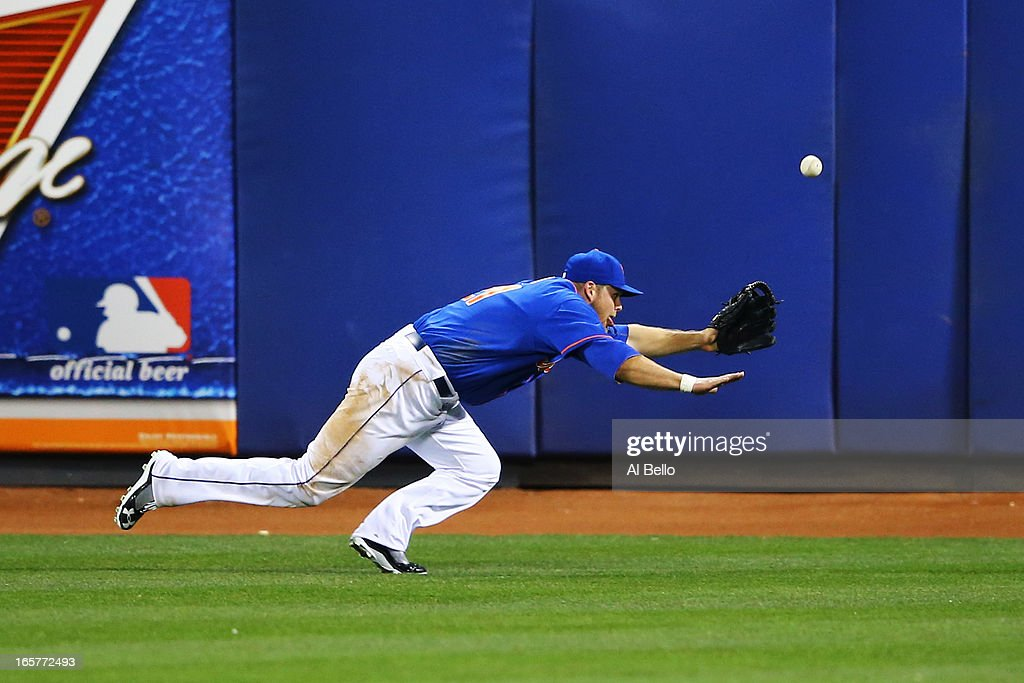 Lucas Duda #21 of the New York Mets misses a ball hit by Justin Ruggiano #20 of the Miami Marlins in the seventh inning during their game on April 5, 2013 at Citi Field in the Flushing neighborhood of the Queens borough of New York City.