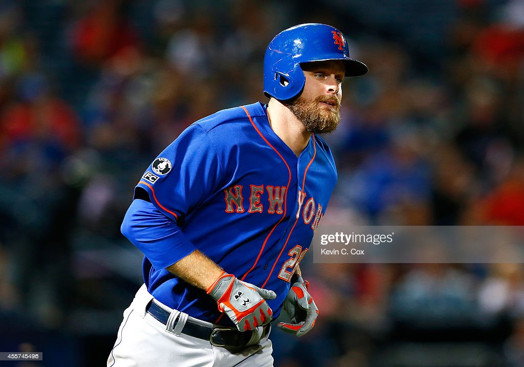 Lucas Duda of the New York Mets rounds first after hitting a tworun homer in the sixth inning against the Atlanta Braves at Turner Field on September...